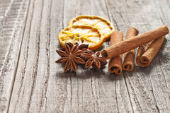 Christmas spices. Christmas decoration with cinnamon sticks, anise and orange Royalty Free Stock Images