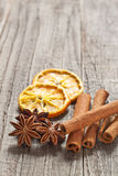 Christmas spices. Christmas decoration with cinnamon sticks, anise and orange Stock Images
