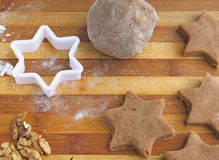 Christmas spices and dough on wooden board Stock Photos