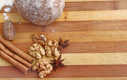 Christmas spices and dough on wooden board Stock Photo
