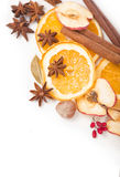 Christmas spices and dried orange sliceson Stock Image