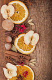 Christmas spices and dried orange sliceson Stock Photo