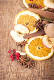 Christmas spices and dried orange sliceson Royalty Free Stock Photography