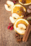 Christmas spices and dried orange sliceson Royalty Free Stock Images