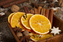 Christmas spices, nuts, dried oranges. In wooden plate Royalty Free Stock Images