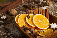 Christmas spices, nuts, dried oranges Stock Images