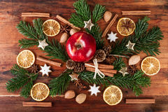Christmas spices and red apple arrangement on rustic wooden table. Top view Royalty Free Stock Photo