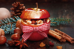 Christmas Spices in Red Apple with Ribbon. Cinnamon Sticks, anise, and Nuts on Side stock photography