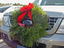 Christmas Spirit. Wreath on car grille Royalty Free Stock Photo