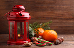 Christmas spirit: nuts, tangerines, Christmas tree, nuts, a flashlight Royalty Free Stock Images