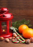 Christmas spirit: nuts, tangerines, Christmas tree, nuts, a flashlight Stock Photo