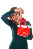 Christmas spirit. Picture of a happy smiling woman holding Christmas decoration Royalty Free Stock Photography