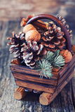Christmas spirit: pine cones in a basket Stock Images