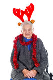 Christmas spirit. Portrait of an elderly woman wearing Christmas decoration on an isolated background Royalty Free Stock Image