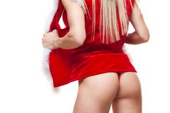 Christmas. Sport, activity. Muscular beautiful sexy girl wearing santa claus clothes  on white Royalty Free Stock Image