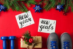 Christmas sport composition dumbbells sneakers new year new goal stock photography