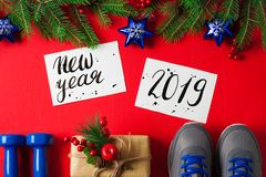 Christmas sport composition dumbbells sneakers new year 2019 let stock photos