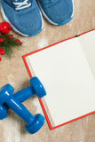 Christmas sport composition with  shoes, dumbbells and note Stock Image