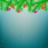 Christmas spruce blue winter background. Green spruce and Christmas decoration snow blue sky background. Falling snowflakes fir tree parts toys pine cones Royalty Free Stock Photos