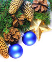 Christmas spruce twigs, cones, star and baubles  Royalty Free Stock Images