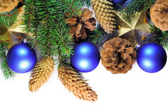 Christmas spruce twigs, cones, stars and baubles  Royalty Free Stock Photography