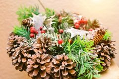 Christmas spruce wreath with cones decorations stock image