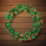 Christmas square wooden background with pine wreath. Pine branches with needles and cones in garland. High detailed vector template. There is copy space for Royalty Free Stock Images