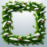 Christmas square wreath with snow and pinecones Royalty Free Stock Images