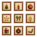 Christmas squares. Square christmas decorations with motifs isolated on white Royalty Free Stock Image