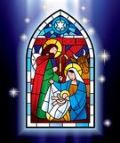 Christmas stained glass window. Raster version of vector image of the stained glass window depicting Christmas scene against a luminescent blue background with stock illustration