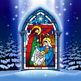 Christmas stained glass window in winter forest Stock Image