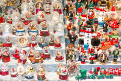 Christmas stall with snow balls and several puppets Stock Photography