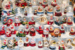 Christmas stall with snow balls and several puppets Royalty Free Stock Images