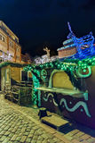Christmas stalls decorated with glowing deer figures in old Riga Stock Photo
