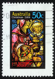 Christmas stamp printed in Australia shows birth of Jesus Christ, adoration of the Magi Stock Photography