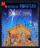Christmas stamp printed in the Croatia shows Christmas Creche. A greeting Christmas stamp printed in the Croatia shows Christmas Creche, circa 1999 stock photo