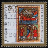 Christmas stamp printed in the Germany shows birth of Jesus Christ, adoration of the Shepherds Stock Photos