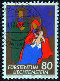 Christmas stamp printed in Liechtenstein shows Holy Family Royalty Free Stock Photos