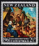 Christmas stamp printed in New Zealand shows birth of Jesus Christ, adoration of the Magi Royalty Free Stock Photography