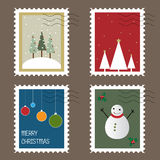Christmas stamps. Set of four Christmas stamps isolated on brown background.EPS file available Royalty Free Stock Photos