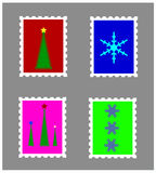 Christmas stamps. Set of four Christmas stamps isolated on brown background.EPS file available Stock Photography