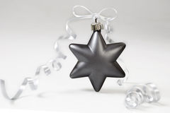 Christmas star. Grey christmas star with bow on white background Royalty Free Stock Images