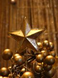 Christmas star. Gold Christmas tree star and balls Stock Photo