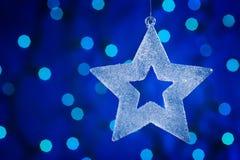 Christmas star. Glass christmas tree. Defocused lights background. aRGB Royalty Free Stock Photos