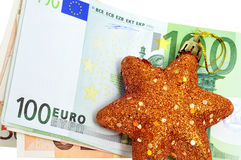 Christmas star. A christmas star with euro bills symbolizing cosumerism Stock Images