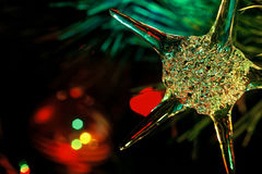 Christmas star. Crystal star-shaped Christmas ornament hanging on tree Royalty Free Stock Photography