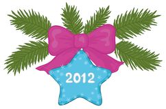 Christmas star. Christmas decoration: star the inscription 2012, snowflakes, bow and green fir branches Stock Photo