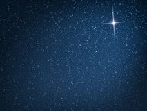 Christmas Star. On evening snowfall Royalty Free Stock Images