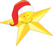 Christmas star. In yellow with Santa clause hat Royalty Free Stock Photo