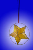 Christmas star. Over blue Stock Photography